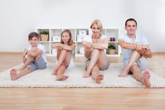 Family Doing Stretching Exercises Royalty Free Stock Photo