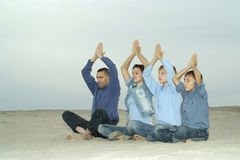 Family doing yoga Royalty Free Stock Photography