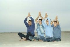 Family doing yoga Royalty Free Stock Photography