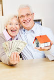 Family with dollar and small house Royalty Free Stock Image