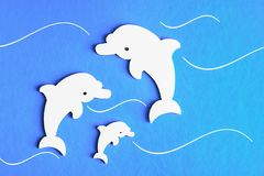 Family of dolphins on a blue background stock image