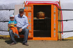 Family at the door of the yurt Royalty Free Stock Images