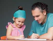 Family draw and write together Royalty Free Stock Photography