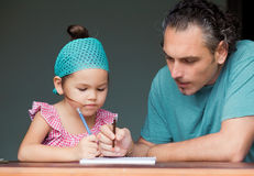 Family draw and write together Royalty Free Stock Photo