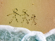 Family drawing. Sand background with family drawing Royalty Free Stock Photos