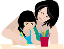 Family drawing. Mom teaches daughter to draw Royalty Free Stock Image