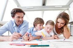 Family drawing pictures Royalty Free Stock Image