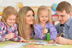 Family drawing pictures together Stock Images
