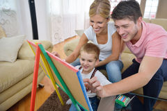 Family drawing on school board at home Stock Images
