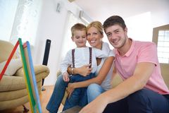 Family drawing on school board at home. Happy young family teach leassons and prepare their son for school while draw on board at home Royalty Free Stock Image
