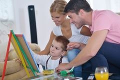 Family drawing on school board at home Royalty Free Stock Photos