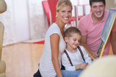 Family drawing on school board at home. Happy young family teach leassons and prepare their son for school while draw on board at home Royalty Free Stock Photography