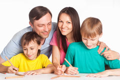 Family drawing at table Stock Photos