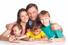 Family drawing at table Royalty Free Stock Photo