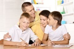 Family drawing at the table. Happy family drawing at the table together Royalty Free Stock Photos