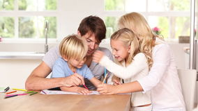 Family drawing at the table Royalty Free Stock Photo