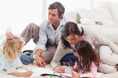 Family drawing together Royalty Free Stock Photos