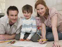 Family Drawing Together On Floor Stock Photography