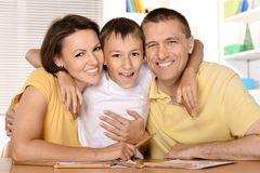 Family  drawing together. Family and son are drawing together with pencils Stock Photo