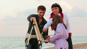 Family Draws On The Sea stock footage
