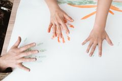 The family draws together. The family draws with palms. Three hands closeup Royalty Free Stock Photos