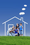 Family with dream house. Portrait of asian family with dream house playing bubble outdoor Royalty Free Stock Photo