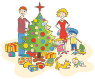 Family dressing up the christmas tree Royalty Free Stock Images
