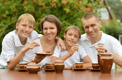 Family drink tea together outdoors. With sweets Royalty Free Stock Images