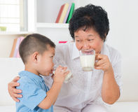 Family drinking milk Stock Images