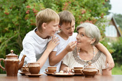 Family drinking tea in garden Stock Photos