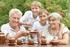 Family drinking tea in garden Stock Photography