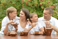 Family drinking tea in garden Royalty Free Stock Photo