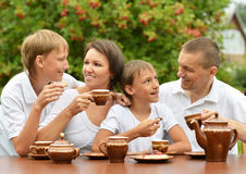Family drinking tea Royalty Free Stock Image