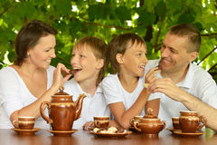 Family drinking tea Stock Image
