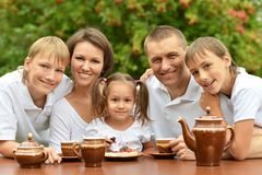 Family drinking tea Stock Images