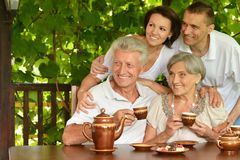 Family drinking tea Stock Photos