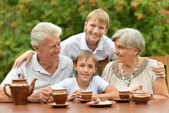 Family drinking tea Royalty Free Stock Photography