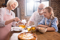 Family drinking tea at home Royalty Free Stock Photography