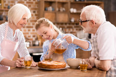 Family drinking tea at home Royalty Free Stock Images