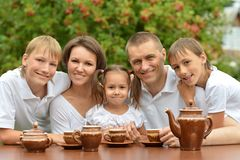 Family drinking tea outdoors Royalty Free Stock Photos