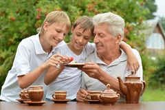 Family drinking tea outdoors Royalty Free Stock Photo