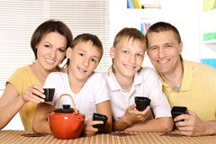 Family drinking tea at table Stock Image
