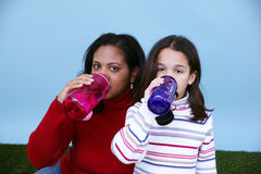 Family Drinking Water Royalty Free Stock Photos