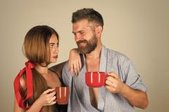 Family drinks morning coffee. Refreshment and energy, break. Men and girl with mulled wine on grey background. Perfect morning with coffee. couple in love royalty free stock photos
