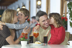 Family With Drinks At Restaurant Royalty Free Stock Photography