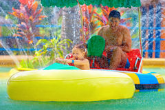 Family drive watercraft in aqua park, trying to hit each other Stock Images