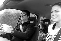 Family drives together in a car during a road trip Royalty Free Stock Photo