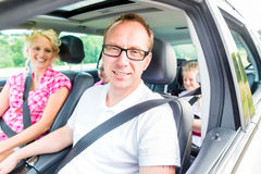 Family driving in car. With seat belt fastened Royalty Free Stock Photography