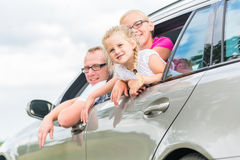 Family driving by car in summer vacation Royalty Free Stock Photography