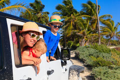 Family driving off-road car on tropical beach Royalty Free Stock Images